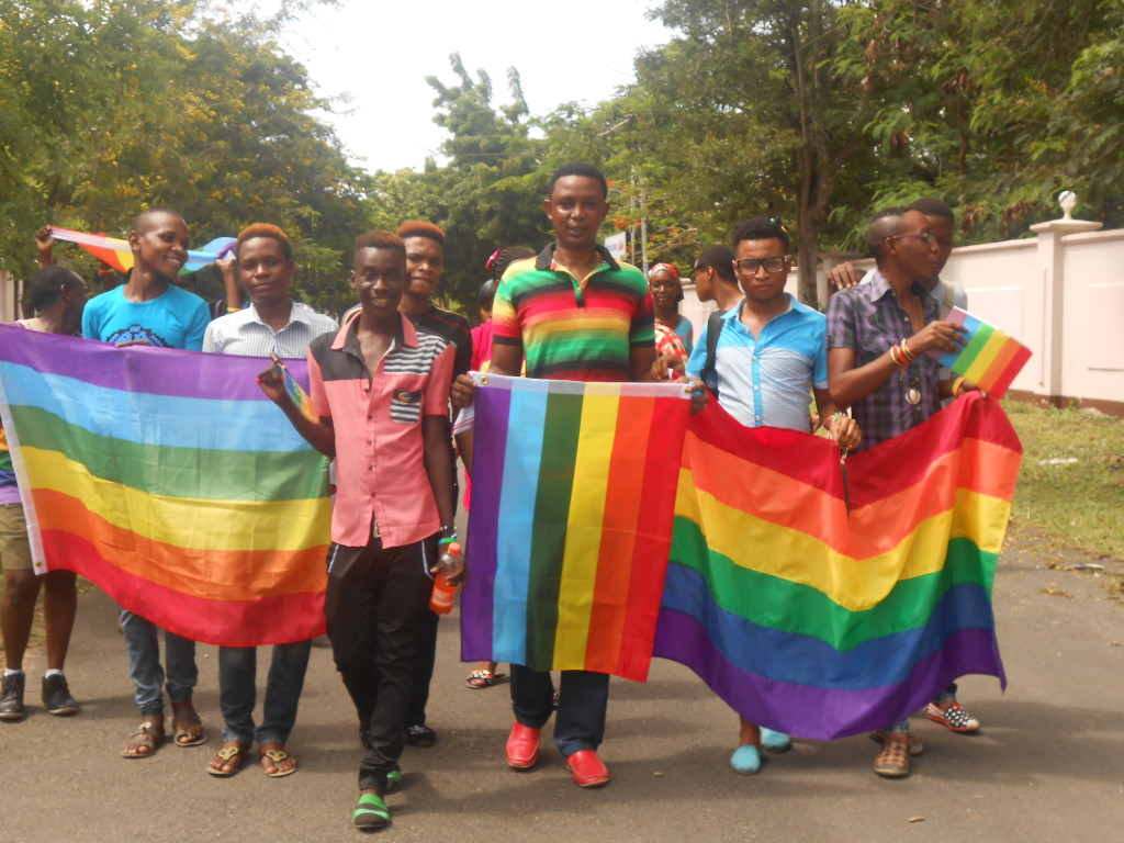 LGBTIQ with rainbow flags standing to support equality